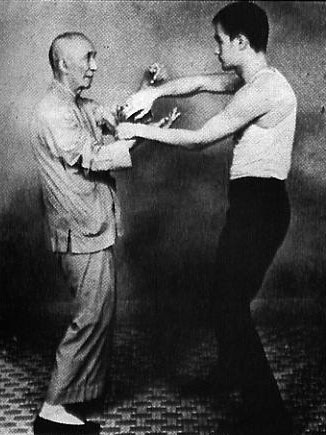 Old photo of Master Ip man training with Bruce Lee